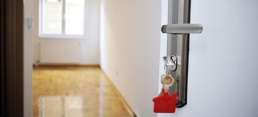 Key in lock opening a door