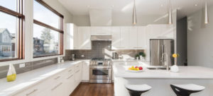 White kitchen stove range hood and stools
