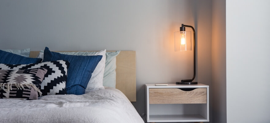 Bed, bedside table and lamp