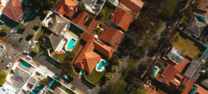 Aerial view of houses, backyards and pools