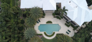 Aerial view of large house and pool