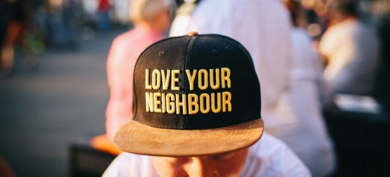 Man with cap saying love your neighbour
