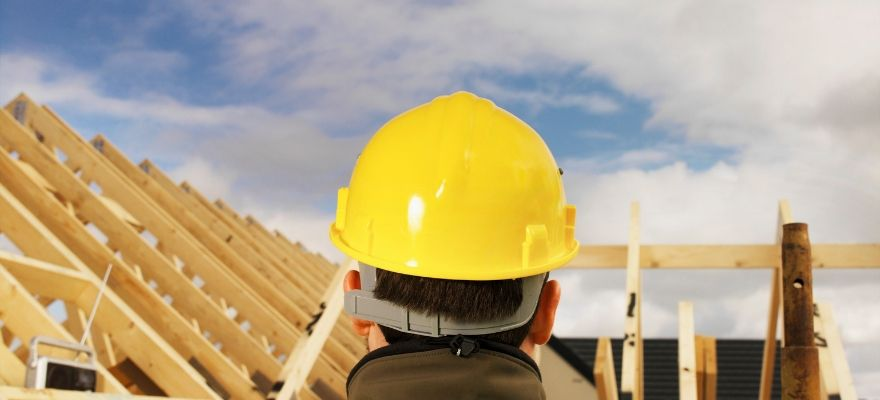 Person wearing a hard hat on construction site