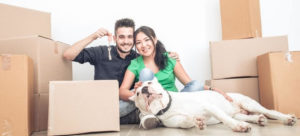 Couple with dog and boxes